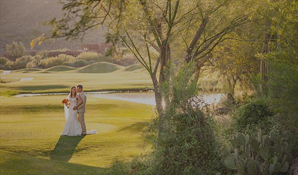 Wedding couple under tree grove
