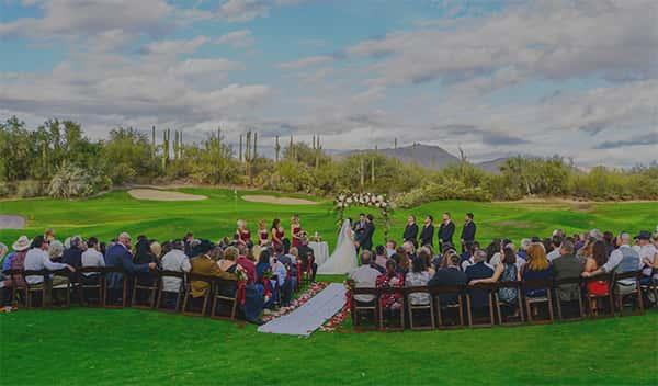 outdoor wedding ceremony in green field