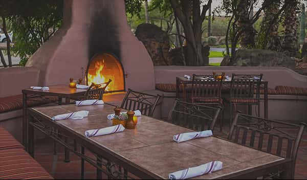 outdoor dining patio with fireplace
