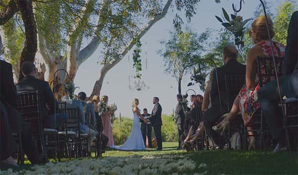wedding ceremony under tree grove